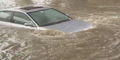 Image of a flooded car with water above the doors